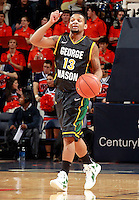 CHARLOTTESVILLE, VA- DECEMBER 6: Corey Edwards #13 of the George Mason Patriots handles the ball during the game on December 6, 2011 against the Virginia Cavaliers at the John Paul Jones Arena in Charlottesville, Virginia. Virginia defeated George Mason 68-48. (Photo by Andrew Shurtleff/Getty Images) *** Local Caption *** Corey Edwards