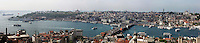 Panoramic view of Galata Bridge, 1994, Golden Horn, Istanbul, Turkey. The Galata bridge, the fifth between Karakoy and Eminonu,, was built by STFA and designed and supervised by GAMB. It is a 490 m long bascule bridge, with a main span of 80 m, and a 42 m wide deck and has 3 traffic lanes and one walkway in each direction plus tram tracks connecting suburban  Zeytinburnu to Kabatas. Picture by Manuel Cohen.