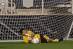 13 November 2009: Wake Forest's Akira Fitzgerald saves a penalty kick attempt from Virginia's T.J. Cyrus (not pictured) during the shootout. The University of Virginia Cavaliers defeated the Wake Forest University Demon Deacons 4-3 on penalty kicks after the game ended in a 0-0 tie after overtime at WakeMed Stadium in Cary, North Carolina in an Atlantic Coast Conference Men's Soccer Tournament Semifinal game.