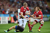 John Moonlight of Canada is tackled by Florin Surugiu of Romania. Rugby World Cup Pool D match between Canada and Romania on October 6, 2015 at Leicester City Stadium in Leicester, England. Photo by: Patrick Khachfe / Onside Images