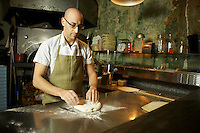 JERSEY CITY, NJ - FEBRUARY 12, 2014: Chef Dan Richer of Razza Pizza Artigianale kneading pizza dough. CREDIT: Clay Williams for Edible Jersey.<br /> <br /> <br /> &copy; Clay Williams / http://claywilliamsphoto.com