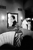 Memphis, Tennessee<br /> USA<br /> August 14, 2002<br /> <br /> A bride passes through the lobby of the Heartbreak Hotel during &quot;Elvis Week&quot; which marked the 25th Anniversary of the King's death.