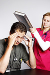 Two medical students studying together pounding the information into his head
