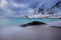 Stormy winter landscape at Haukland beach, Vestvågøy, Lofoten Islands, Norway