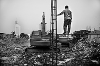 "Welders look over a demolition site where hutongs, small residential alleys, once stood in the center of Tianjin, China.  A local resident said that the relocated residents were compensated for their houses but it was ""not enough.""  Tianjin has demolished almost all of the hutongs in the city to make way for ""modern"" construction projects."