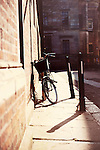 a bicycle leaning against a wall in Cambridge, England