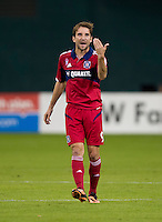 Mike Magee (9) of the Chicago Fire yells to a teammate during a Major League Soccer game at RFK Stadium in Washington, DC.  The Chicago Fire defeated D.C. United, 3-0.