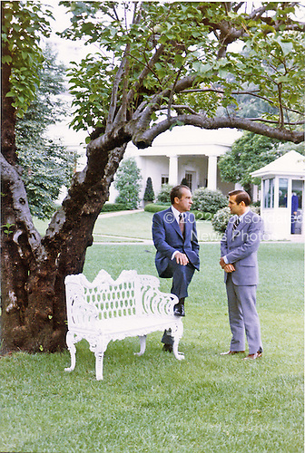 Washington, DC - July 23, 1972 -- United States President Richard M. Nixon, left, meets with one of his his counselors Donald H. Rumsfeld, right, under a tree outside the Oval Office at the White House in Washington, D.C. on July 23, 1972.<br /> Credit: White House via CNP