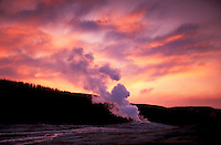 Old Faithfull Geyser at sunset, Yellowstone National Park, Wyoming, USA