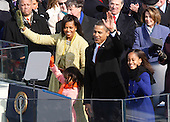 Washington, DC - January 20, 2009 -- Obama family wave from the West Front of the United States Capitol during the inauguration ceremony in Washington, Tuesday, January 20, 2009..Credit: Jim Bourg - Pool via CNP