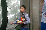 A Tibetan student buys snacks during a break from class at TCV, the Tibetan Children's Village. McLeod Ganj, Dharamsala, India. 7/29/05. This is a school for Tibetan exile children run by the Tibetan government in exile.
