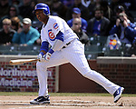 CHICAGO - APRIL  05:  Starlin Castro #13 of the Chicago Cubs bats against the Arizona Diamondbacks on April 5, 2011 at Wrigley Field in Chicago, Illinois.  The Cubs defeated the Diamondbacks 6-5.  (Photo by Ron Vesely) Subject: Starlin Castro