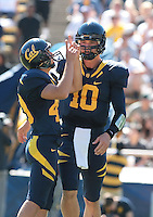 Giorgio Tavecchio (right) and Brock Mansion (10) after the extra point. The University of California Berkeley Golden Bears defeated the UC Davis Aggies 52-3 in their home opener at Memorial Stadium in Berkeley, California on September 4th, 2010.