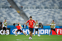 Germany manager Joachim Low with players warming up behind