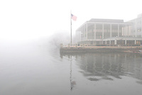A flag flutters in the fog outside the Below Alumni Center and Pyle Center on a misty winter morning beside Lake Mendota.<br /> <br /> Client: University of Wisconsin-Madison<br /> &copy; UW-Madison University Communications 608-262-0067<br /> Photo by: Michael Forster Rothbart<br /> Date: 12/06    File#:  D200 digital camera frame 5365.