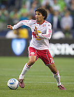 New York Red Bulls midfielder Mehdi Ballouchy dribbbles the ball during play against the Seattle Sounders FC at Qwest Field in Seattle Saturday June 23, 2011. The Sounders won the game 4-2.