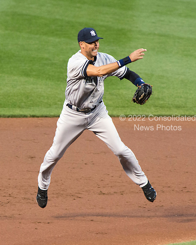 New York Yankees shortstop Derek Jeter (2) throws out J.J. Hardy (2) in the first inning against the Baltimore Orioles at Oriole Park at Camden Yards in Baltimore, MD on Monday, April 9, 2012..Credit: Ron Sachs / CNP.(RESTRICTION: NO New York or New Jersey Newspapers or newspapers within a 75 mile radius of New York City)