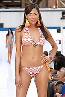 Model walks runway in a Johanna Sarria 2012 swimsuit by Johana Sarria, during the JRG Bikini Under The Bridge 2012 fashion show on July 9, 2012.