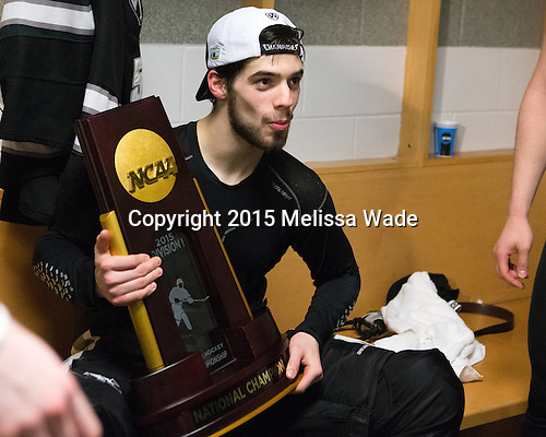 Kyle McKenzie (PC - 5) - The Providence College Friars celebrated their national championship win after the Frozen Four final at TD Garden on Saturday, April 11, 2015, in Boston, Massachusetts.