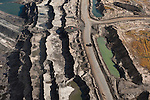 At the edge of an 80 meter deep mine, a massive tar sands truck is dwarfed by the surrounding landscape. These 400 ton trucks are the world's largest. The mines, machinery, and trucks of the Alberta Tar Sands were the inspiration for Avatar's Edmonton born art director's vision of the mining operation on Pandora. However, the first reaction of most visitors to the tar sands is that the vast mines, tailings ponds, and fire and pollution belching refineries, remind them of nothing more than a vision of Tolkien's Mordor.
