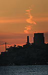 Morning cloud appears like smoke over Coit Tower in San Francisco, California.