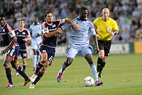 C. J Sapong (17) Sporting KC forward holds off the challenge of Benny Fellhaber New England... Sporting Kansas City defeated New England Revolution 3-0 at LIVESTRONG Sporting Park, Kansas City, Kansas.