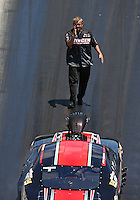 Jun 18, 2016; Bristol, TN, USA; Crew member for NHRA pro mod driver Mike Janis during qualifying for the Thunder Valley Nationals at Bristol Dragway. Mandatory Credit: Mark J. Rebilas-USA TODAY Sports