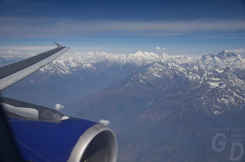 Aerial view of Mt Everest and the Himalayas on the way to Bhutan.