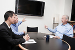 July 29, 2011. Cary, NC.. John Sall, the Executive VP of SAS, right, meets with colleagues Bryan Yan, General Manager of JMP Greater China, left, and Jon Weisz, Director of Sales and Marketing, in his office.. Profile of SAS, a software company that has many amenities for its employees.