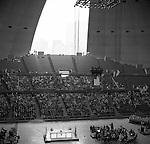 Pittsburgh PA:  On location photography for the Council of Churches. Easter Sunrise Service, the Civic Arena roof in the process of opening - 1963. The Council of Churches was a merger of three local groups; Allegheny County Sabbath School Association, the Pittsburgh Council of Churches and the Council of Weekday Religious Education.  The council's objection was to better relate and understand other religions including the local Jewish, African American, Catholic and Christian churches in the downtown Pittsburgh area.