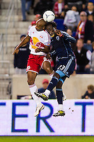 Thierry Henry (14) of the New York Red Bulls goes up for a header with Kei Kamara (23) of Sporting Kansas City. The New York Red Bulls and Sporting Kansas City played to a 0-0 tie during a Major League Soccer (MLS) match at Red Bull Arena in Harrison, NJ, on October 20, 2012.