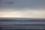 The Pacific Ocean at dusk on an overcast day, as seen from El Matador Beach, Malibu, California, USA
