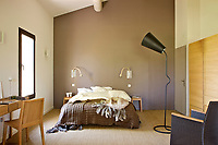 The bedroom is decorated in restful shades of taupe