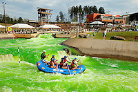 The US National Whitewater's recirculating rapids course turned brilliant lime green on St. Patrick's Day 2012. The event, called the Green River Revival, included live music and green water.
