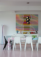 A colourful psychedelic artwork is the focus of the dining area