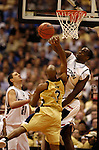 5 APR 2004: UConn center and the Most Outstanding Player Emeka Okafor (#50) blocks a shot attempt by Georgia Tech guard Jarrett Jack (#3) during the Division I Men's Basketball championship game held at the Alamodome in San Antonio, TX. The University of Connecticut defeated Georgia Tech 82-73 for the championship title. Ryan McKee/NCAA Photos
