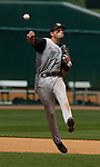 04 Jun 2006 Lincoln, NE Manhattan University's Rene Ruiz makes a late throw in the sixth inning and the runner was safe  during the NCAA Baseball Regionals at Hawks Field at Haymarket Park in Lincoln, Ne Sunday afternoon.(Chris Machian/Prairie Pixel Group)