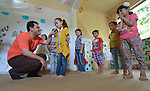 Emad Almoqari leads a group of children in an activity at the Youth Empowerment Center in Beit Hanoun, Gaza. The program is supported by Caritas and DanChurchAid, a member of the ACT Alliance, and is designed to help children better cope with the trauma they experienced during the 2014 war.<br /> <br /> In the wake of that war between the government of Gaza and the government of Israel, ACT Alliance members are supporting health care, vocational training, rehabilitation of housing and water systems, psycho-social care, and other humanitarian actions throughout the besieged Palestinian territory.