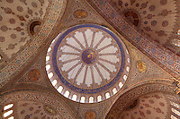 Detail of ornate tiled ceiling, Sultan Ahmed Mosque, or Blue Mosque, 1609-16, by Mehmet Aga, Istanbul, Turkey. Built near the Hagia Sophia, the Blue Mosque combines Byzantine style with Islamic architecture. The blue tiles of the interior inspired its popular name, The Blue Mosque. The historical areas of the city were declared a UNESCO World Heritage Site in 1985. Picture by Manuel Cohen.