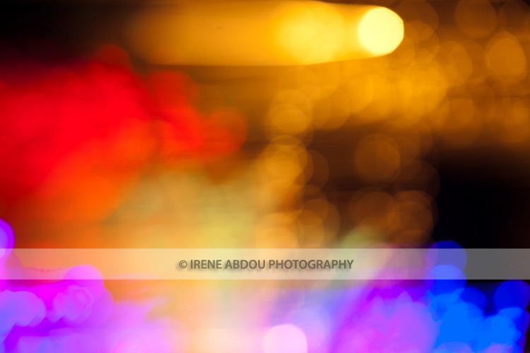 """At a holiday light display (Brookside Gardens Garden of Light in Wheaton, Maryland), patterns of light are created by """"de-focusing"""" the camera and moving the camera during a 0.8-second exposure."""