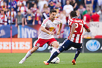 Heath Pearce (3) of the New York Red Bulls is marked by Jose Erick Correa (27) of CD Chivas USA. The New York Red Bulls and CD Chivas USA played to a 1-1 tie during a Major League Soccer (MLS) match at Red Bull Arena in Harrison, NJ, on May 23, 2012.