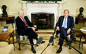 Washington, DC - September 29, 2008 -- United States President George W. Bush meets with Valdas Adamkus, President of Lithuania, in the Oval Office of the White House in Washington, D.C., U.S., Monday, September 29, 2008. .Credit: Joshua Roberts - Pool via CNP