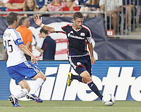 New England Revolution defender Chris Tierney (8) fakes cross and dribbles. In a Major League Soccer (MLS) match, Montreal Impact defeated the New England Revolution, 1-0, at Gillette Stadium on August 12, 2012.