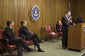 Washington, DC - February 20, 2001 -- United States Federal Bureau of Investigation (FBI) Director Louis J. Freeh announces that veteran FBI counterintelligence Agent, Robert Philip Hanssen, was arrested on Sunday, February 18, 2001 at Foxstone Park in Vienna, Virginia and charged with committing espionage by providing highly classified national security information to Russia and the former Soviet Union. Left to right: Attorney General John Ashcroft;  Central Intelligence Agency (CIA) Director George Tenet; U.S. Attorney Helen Fahey; and Director Freeh..Credit: Ron Sachs / CNP