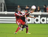Collin Martin (32) of D.C. United heads the ball against Patrick Nyarko (14) of the Chicago Fire.  The Chicago Fire defeated D.C. Untied 3-0, at RFK Stadium, Friday October 4 , 2013.