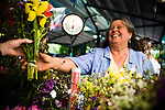 Annie Main of Good Humus Farm sells flowers at the Davis Farmer's Market in Davis, CA May 9, 2009.