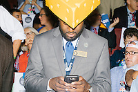 Wisconsin delegates wear cheesehead hats on the final day of the Democratic National Convention at the Wells Fargo Center in Philadelphia, Pennsylvania, on Thurs., July 28, 2016.