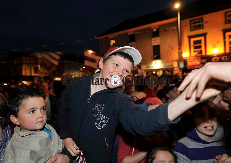 Youngsters reach for their heros at the victorious Galway minors All-Ireland homecoming in Gort. Photograph by John Kelly.
