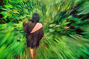 Ashaninka woman walking through forest, Vilcabamba, Peru