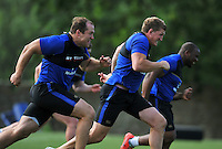 Bath Rugby forwards led by Stuart Hooper in action. Bath Rugby training session on August 4, 2015 at Farleigh House in Bath, England. Photo by: Patrick Khachfe / Onside Images